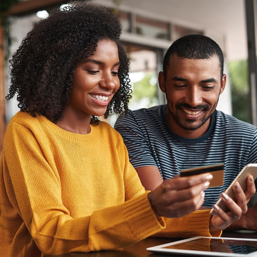Man and Woman looking at the screen of a phone