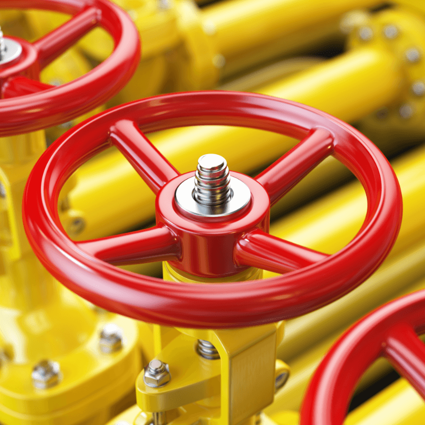 Red valve on yellow pipes
