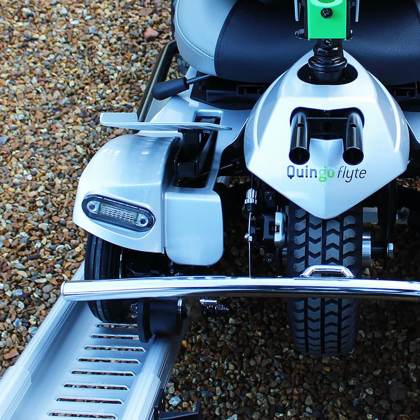 A close up photograph of a Quingo Flyte electric scooter