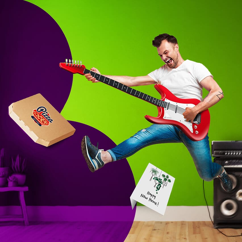 Man playing guitar, jumping in the air, and a pizza box, photograph of elderly people, and New Home Card flying around the room