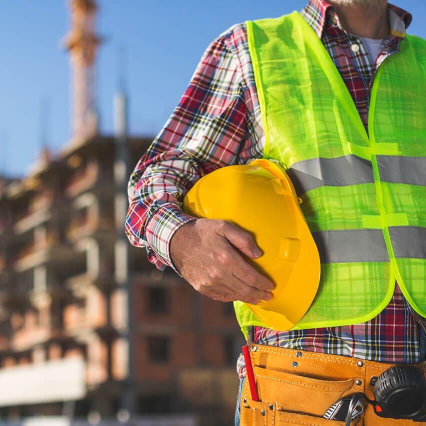Rainbow International engineer holding hard hat